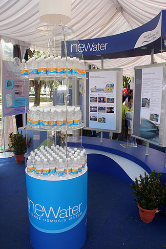 Bottles of NEWater for distribution at a public exhibition during the National Day Parade celebrations: Marina South, Singapore in 2005 Photograph by Huaiwei courtesy of Wikipedia