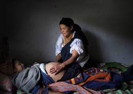 Midwife and expectant mother in Otavalo, Ecuador.