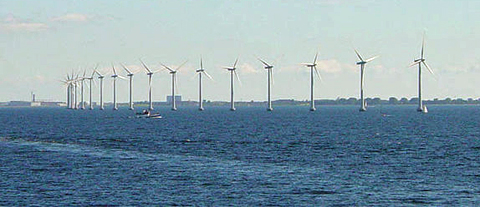 Middelgrunden offshore wind park.  Danish wind turbines near Copenhagen.: Wind often flows briskly and smoothly over water since there are no obstructions. The large and slow turning turbines of this offshore wind farm near Copenhagen take advantage of the moderate yet constant breezes at this location. While the wind at this location is not strong it is very consistent, with the turbines generating substantial power over 97 percent of the time.  Photograph courtesy of English Wikipedia, original upload 15 July 2004 by Leonard G.