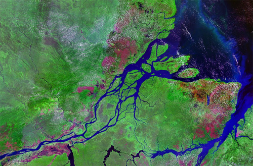 The Amazon River in South America is generally regarded as the second longest river in the world and is: by far the largest by water flow with an average discharge of about 209,000 cubic meters per second. The Amazon runs through Brazil, Columbia and Peru.  Text and image courtesy of Wikipedia