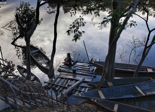 A client waits on one of the docks leading up from the Amazon to the village.