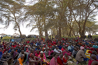 Many members of the Maasai community gather to watch the signing of a lease agreement: between IFAW and the Maasai community, 17 July 2013, Amboseli National Park, Kenya. © IFAW/K. Prinsloo