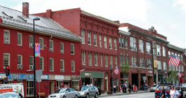 Main Street in Montpelier, Vermont. A mix of shops, offices, and apartments in the city's downtown: create a neighborhood where residents are close to a lively arts and music scene, restaurants, and businesses. Photograph source: EPA.