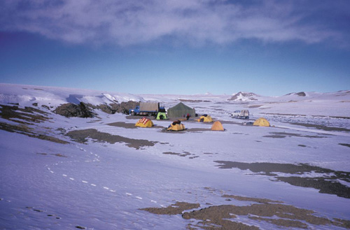 Our night camp in the spacious northern Chang Tang. In our west to east traverse, we did not encounter any people in 1000 miles: of cross-country driving. Photograph from Tibet Wild by George B. Schaller. Reproduced by permission of Island Press.