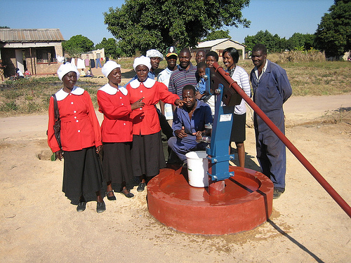Residents admire their Bush Pump, in this case one fitted with extractable piston, making maintenance easier.: Photograph by PRM