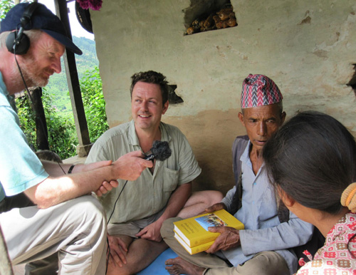 Returning a copy of my grammar of the Thangmi language to my language teacher and his daughter,: witnessed by the BBC, Cokati, Nepal Photograph by Hikmat Khadka, August 2012